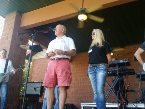 Bella Vista, Ark. Mayor Peter Christie and Tara Hammarstrom of Simple Pleasures open up the event.