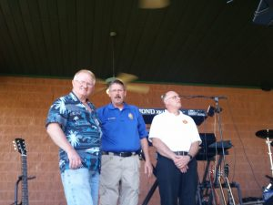 Ken Miner, Owner of Simple Pleasures, Police Chief Ken Farmer and Fire Chief Steve Sims.