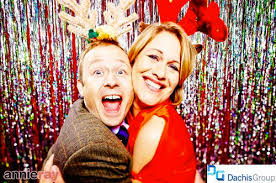 Photo booths are must have items at your next holiday party. (Flickr)